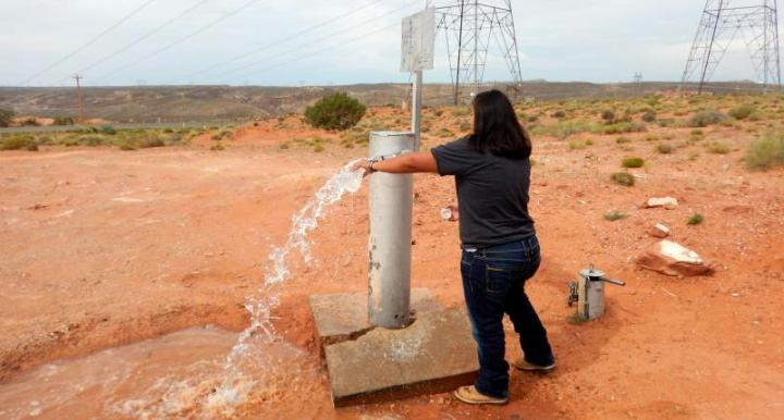 NAU graduate student Andee Lister collects a water sample from an unregulated well in the southwestern region of the Navajo Nation.